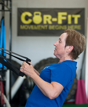 photo by Sarah A. Miller/Tyler Morning Telegraph  Ginger Cobb of Tyler uses suspension straps as she works out Tuesday June 24 at Cor-Fit. Cor-Fit is a functional fitness studio located at 1721 S. Broadway, Suite B in Tyler.
