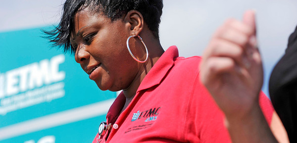 Angelia Jackson (Red Shirt) walks with her coworkers Daphne Warren (striped shirt), Amanda Williams (Brown Shirt), Precious Thomas (Red and black shirts) and Heather Brown (all black shirt) around the ETMC EMS Business Office offices in Tyler on Wednesday, June 02, 2010. Jackson wants to join the military but is concerned about meeting weight guidelines.  Photo By Tom Turner