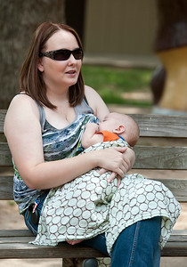 "photo by Sarah A. Miller/Tyler Morning Telegraph  Ashley Crerend of Tyler, Texas breastfeeds her three-month-old son Nathan Crerend Wednesday July 16, 2014 at Bergfeld Park in Tyler. Crerend's friend Erin Menard of Henderson is hosting a local event tied to the global event on Aug. 2 called Big Latch On 2014. For one minute at Bergfeld Park, women will nurse their babies for a full minute. The purpose is to ""normalize"" breastfeeding, or make women feel supported and comfortable to do it in public. It also brings awareness to the public about breastfeeding."