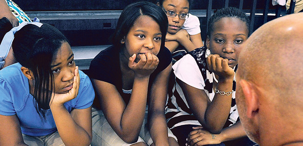 Victoria Williamas, Maya Walker, Erin Brinkley and Genesis Renee' Borens, from left, listen to trainer Kelly Hitchcock at the Aim High class at the Boys and Girl's club of East Texas in Tyler Thursday afternoon. Herb Nygren Jr 070810
