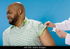TA1.8 m014 / Choice 3 of 8 / AKK1HD Man receiving injection in arm