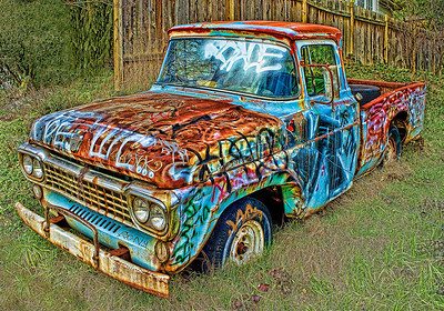 """Truck Tatts"" Tagged for years by local ""artists"", this 1959 Ford F100 has become a work of art in its North Seattle neighborhood."