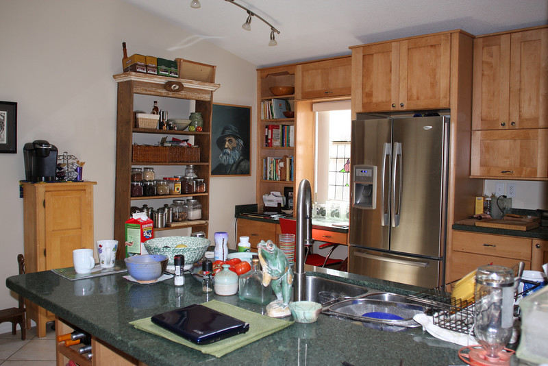 walk across main room and look right toward another view of kitchen