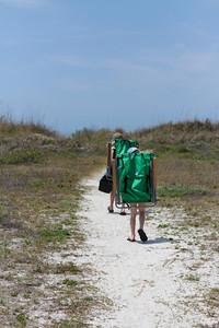 Little sherpas hoofing it to the beach