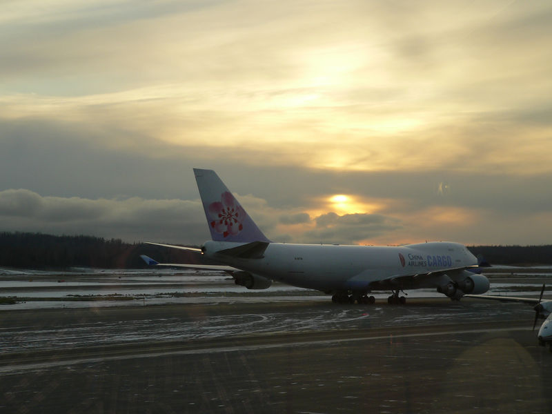 Final 2005 AK Photo:<br /> The sun sets on an incredible aasignment to Anchorage.  A China Airlines Cargo plane prepares to depart for the Far East as I return to NH on 11/1/05.