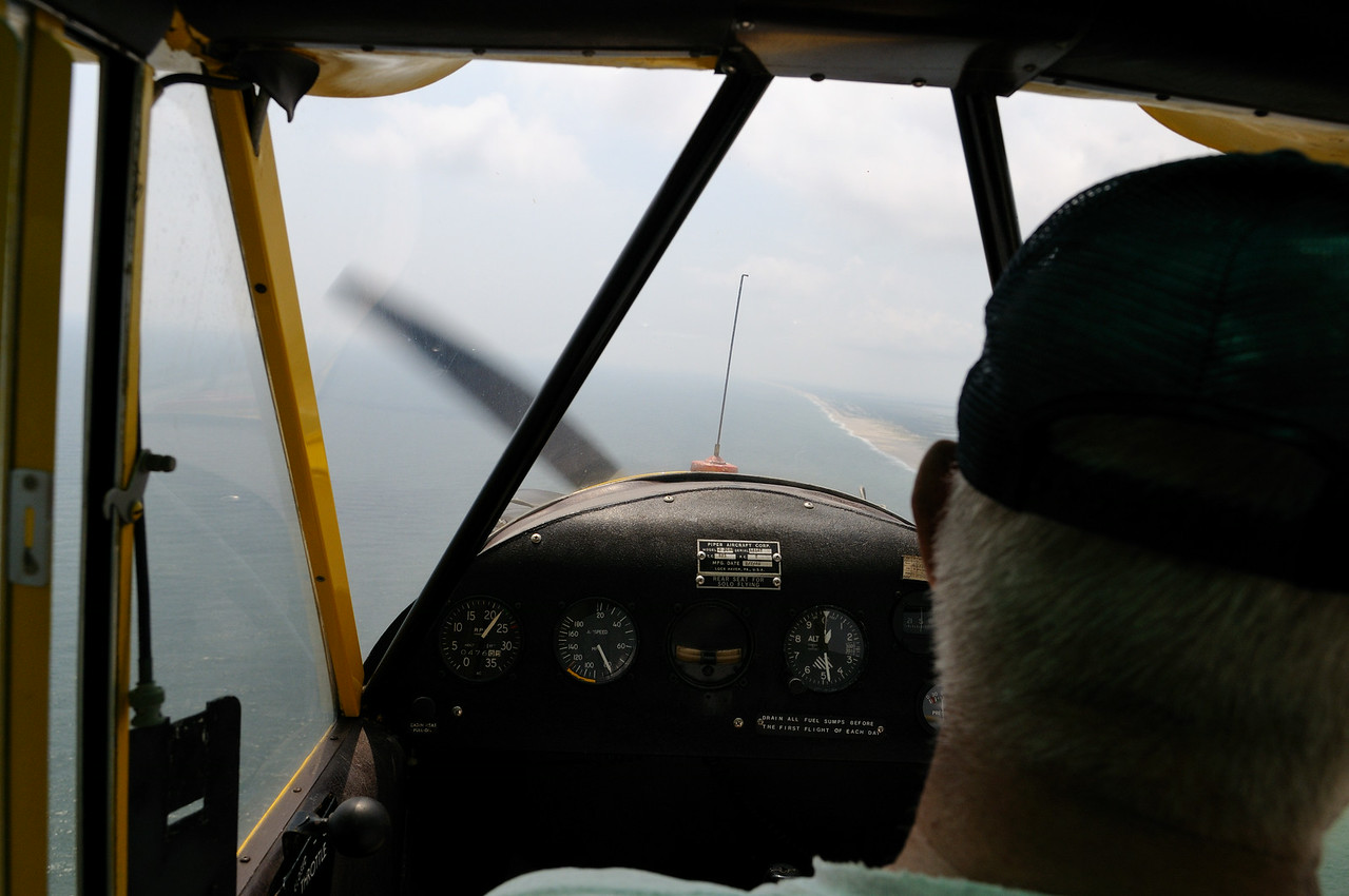 80 mph, 4800 feet, knob on left is the throttle. I had one in the back too...JD said don't hit it.............skinny rod sticking up in the front is the fuel gauge,........did I really do this?
