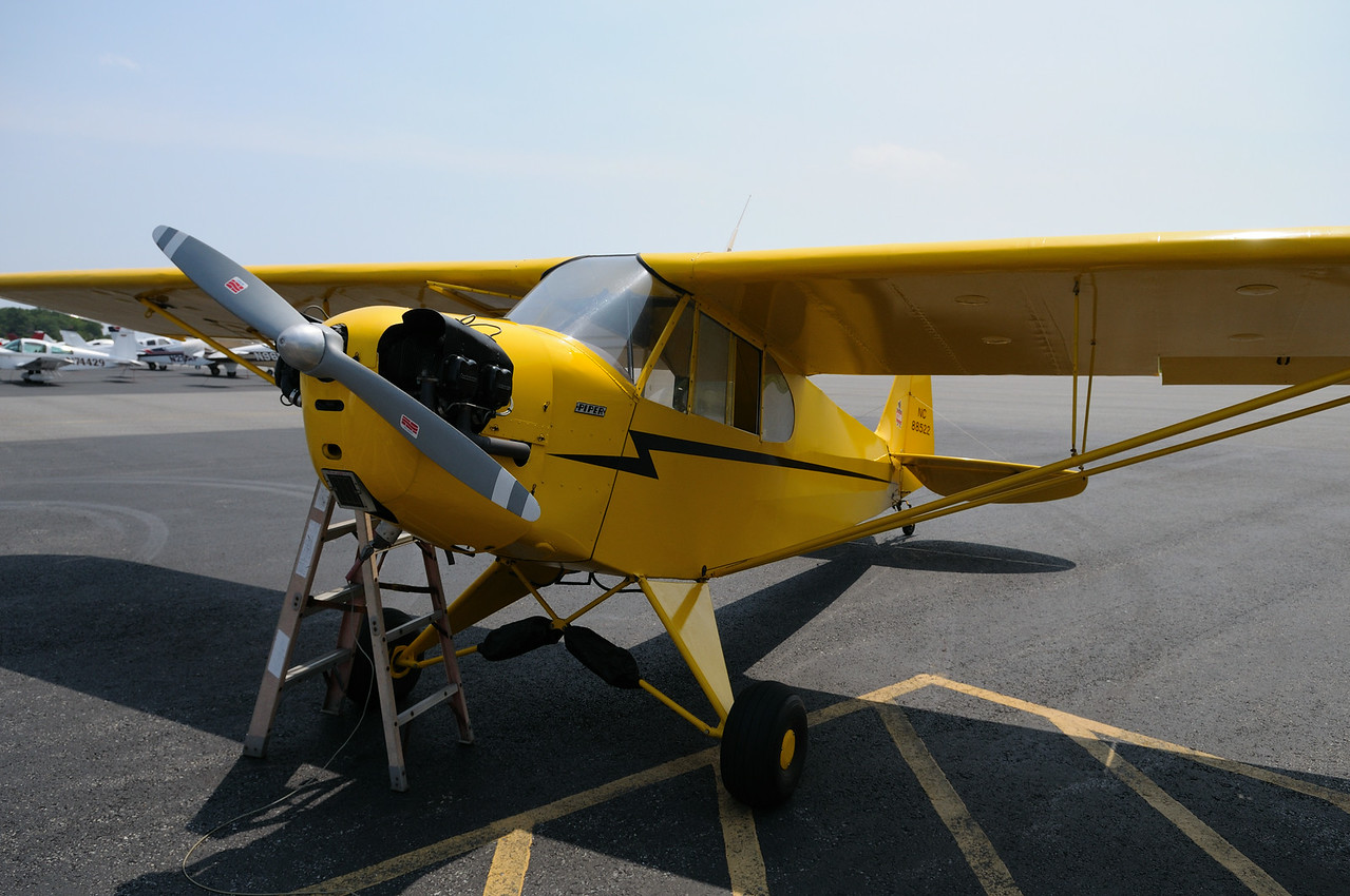 """1940's era Piper Cub. J D said flying this is """"real"""" flying. I have to agree. With a seventy year old aircraft and even older pilot, some might wonder the wisdom of such a flight.......no radar, no door, no parachute..............."""