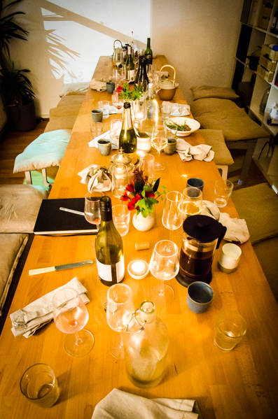 A messy dinner table at the end of the night at the Water House Project Supper Club
