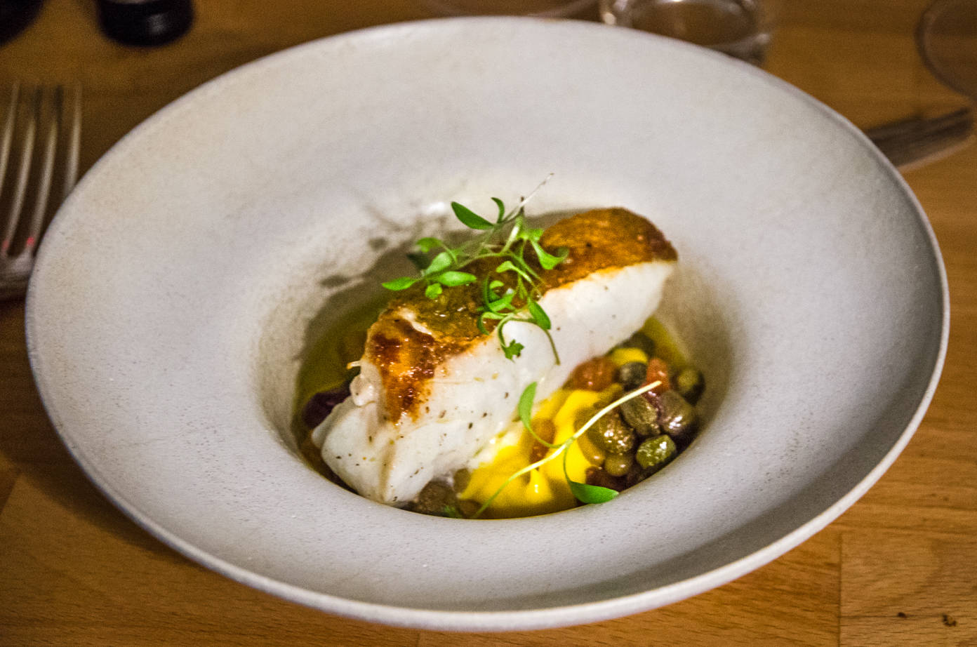 A bowl of Atlantic cod, tumeric and cauliflower purée at the Water House Project Supper Club