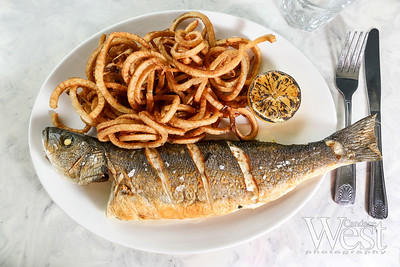 Photo by CandaceWest.com,  Whole branzino with curly fries, Mignonette Uptown: 13951 Biscayne Blvd., North Miami Beach, FL 33181