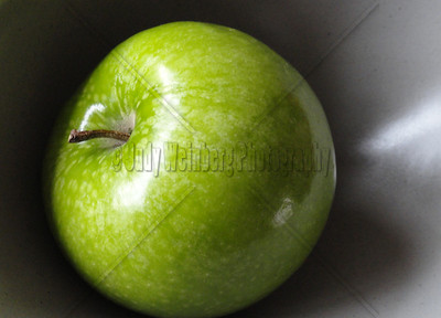 Green Apple in Gray Bowl
