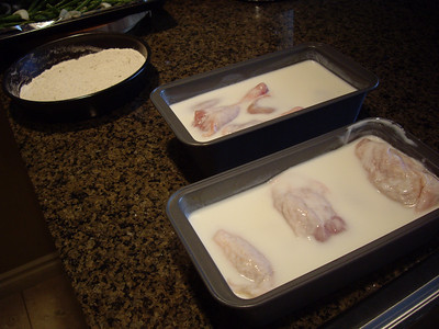 Chicken bathing in buttermilk.