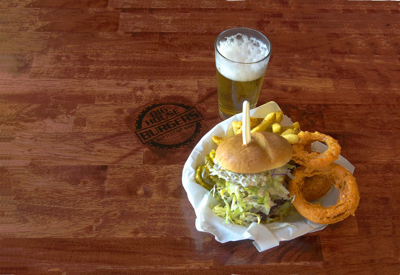"Advertisement base shot for  Big House Burgers and Bottle Cap Bar, Steamboat Springs CO,  new restaurant for Steamboat restaurant group.  Logo is branded into table top. <br /> <br /> <a href=""http://www.exploresteamboat.com/marketplace/businesses/big-house/"">http://www.exploresteamboat.com/marketplace/businesses/big-house/</a>"