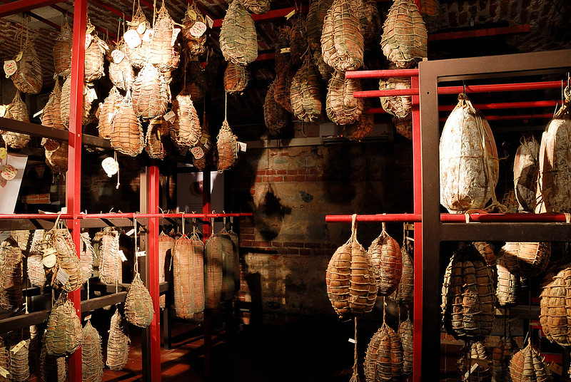A room full of drying salami and cured meats