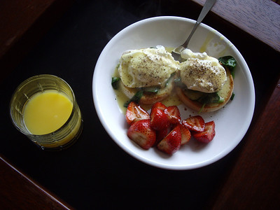 Eggs Benedict with balsamic strawberries.