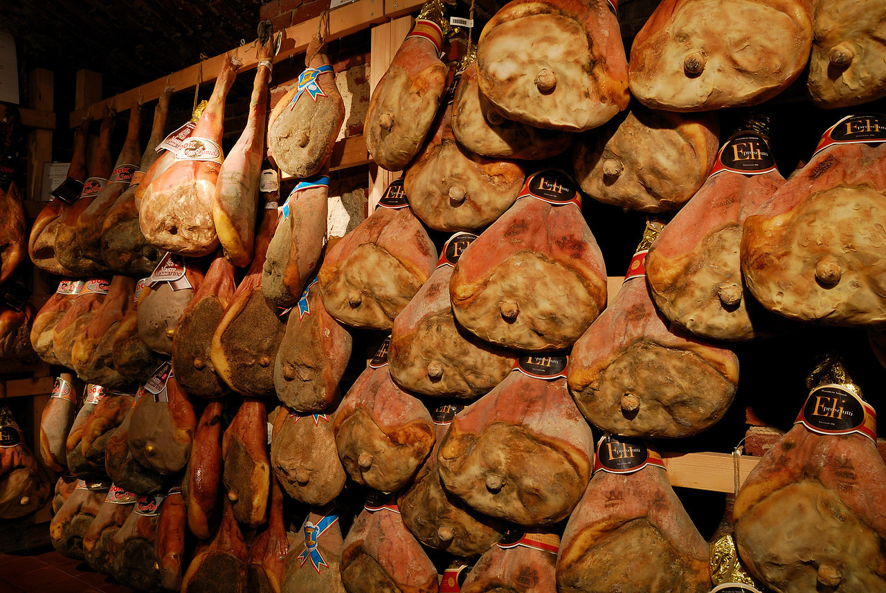 A rack of Prosciutto drying