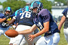 North Penn quarterback Spencer Jones hands off during moring practice.   Monday,  August 11, 2014.   Photo by Geoff Patton
