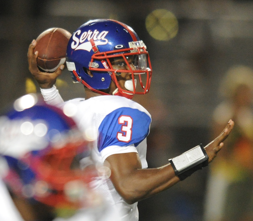 . Serra Cavaliers\' quarterback Jalen Greene looks to pass against Oceanside Pirates in the 2013 Honor Bowl high school football game at Oceanside High School in Oceanside, CA. on Friday, September, 6 2013. (Photo by Sean Hiller/ Daily Breeze)