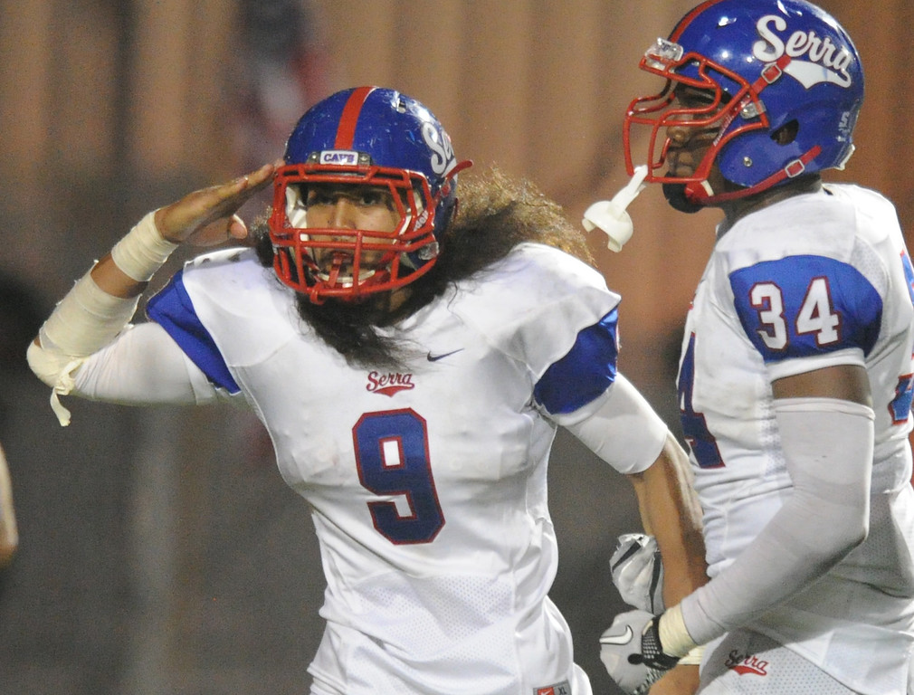 . Serra Cavaliers\' Malachi Mageo (9) salutes after his touchdown on an interception late in the third quarter against the Oceanside Pirates in the 2013 Honor Bowl high school football game at Oceanside High School in Oceanside, CA. on Friday, September, 6 2013. (Photo by Sean Hiller/ Daily Breeze)