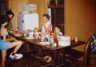 Cheryl, Annie, Aunt Cade, and Bobby at the table. Notice the wax paper covering the paper plates.