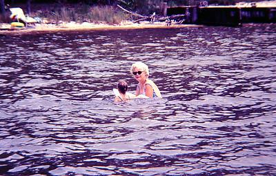 Aunt Cade teaching Robin to swim.