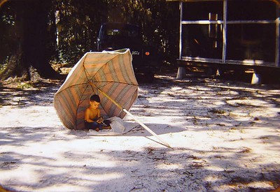Bobby under the umbrella.