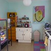 My kitchen, with two painting collages that I did last year