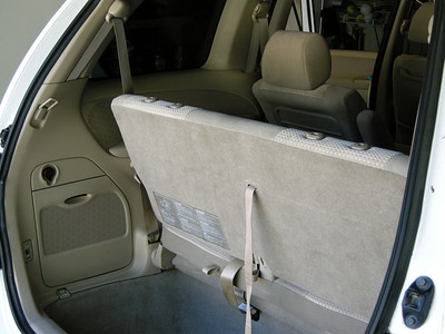 It takes only about 5 seconds to go from 3rd row seat to a completely flat cargo area.   It's as easy as 1....