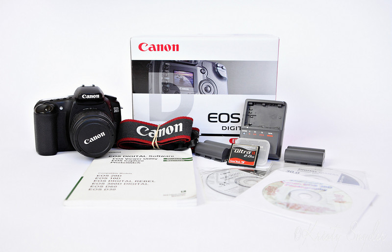 Auction 1<br /> Includes, 20D, 18-55 mm lens, Neck Strap, 2 Batteries, One Charger, 2GB CF card, EOS Digital Solutions Disc, including EOS Utility, DPP, ZoomBrowser eX and more, 20D User Guide on CD, Software USage Manual, and 20D Instruction Manual (not Pictured)