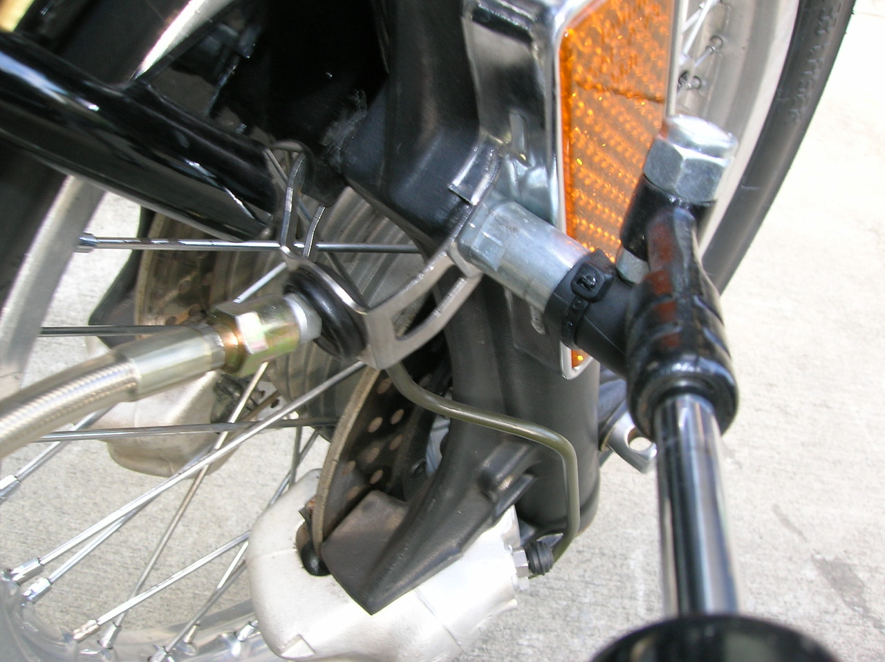 Steering damper mount to right fork slider.