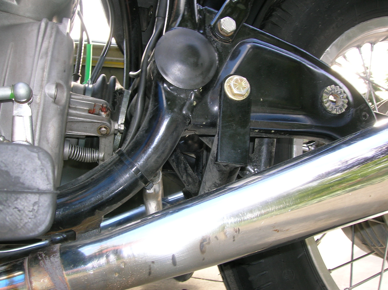 Rear lower mount attachment point on left side.