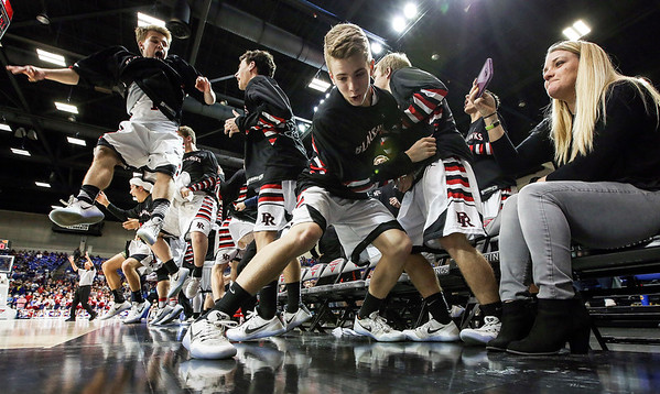 Pea Ridge's bench reacts to a three pointer made in the 4th quarter against Baptist Prep during the Class 4A Boys Championship game at Bank of the Ozarks Arena in Hot Springs Friday, March 10, 2017.