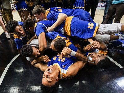 North Little Rock celebrates after winning the Boys 7A Basketball Championships at Bank of the Ozarks Arena in Hot Springs Thursday, March 8, 2018.