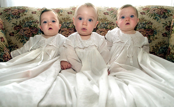 8 month old triplets (L to R) Grace, Joe, and Emily Stacy of Lucas in their Baptismal garments.
