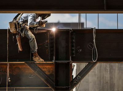 A workers does some welding on a support beam at a construction site North of E. 4th St. in downtown Little Rock Monday, September 12, 2016.