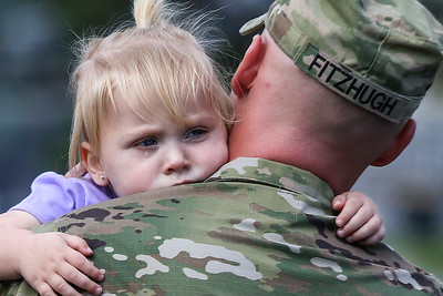 Two year old Reagan Fitzhugh hugs her father SFC John Fitzhugh, both of Conway, before he leaves during the deployment ceremony for the 39th Brigade at Robinson Maneuver Training Center in North Little Rock Sunday, April 2, 2017.  The Soldiers from 2nd Battalion, 39th BCT will be on a six-month mobilization to Central America.  This mission is part of a Regionally-Aligned Forces program through the U.S. Southern Command.