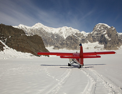 Talkeetna Air Taxi plane on Ruth Glacier in front of Mt. McKinley