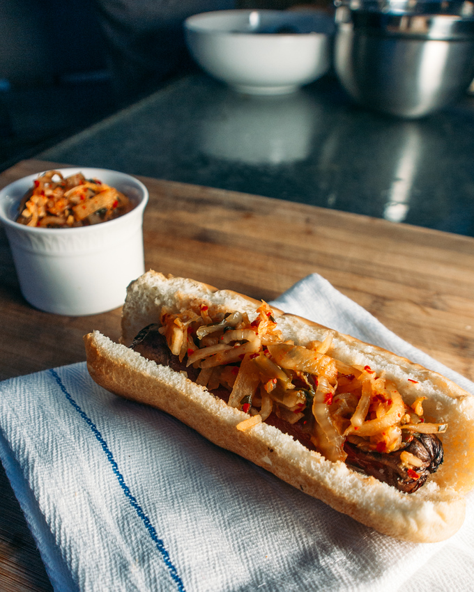 Easy ramp kimchi recipe featured here on a hotdog. This spin on a traditional kimchi recipe is so easy to make and makes great use of foraged ramps.