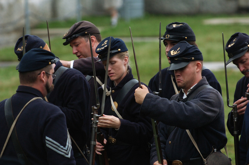 Civil War re-enactors from 12th Massachusetts Company I, 10th Massachusetts Company C and 20th Massachusetts Company D stack their rifles before taking a break before drill at Fort Knox on Saturday. The Battle at Fort Knox in Prospect drew hundreds of people to the three-day re-enactment event.  (BANGOR DAILY NEWS PHOTO BY KEVIN BENNETT)<br /> <br /> CAPTION<br /> <br /> Civial War reenactors from the I Company, 12th Mass., the 10th Mass. Company C,  and the 20th Mass. Company D, stack their rifles prior to taking a break before drill  at Fort Knox on Saturday, July 24, 2010. The Battle at Fort Knox in Prospect drew hundreds of people to the three day reenactor event. (Bangor Daily News/Kevin Bennett)