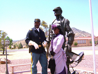 """Cmdr Fred Marable and Pvt. Michelle London-Marable portraying as a Lady of the Regiment instead of a """"Buffalo Soldier"""" Cathy William today."""