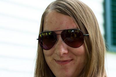 Gennie wearing my sunglasses.