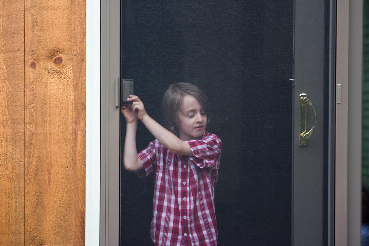 Gus opening the screen door.