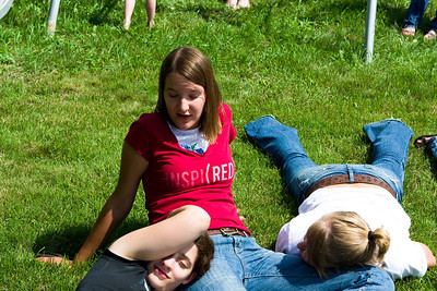 Alli, Gennie, and Molly collapsed on the grass.