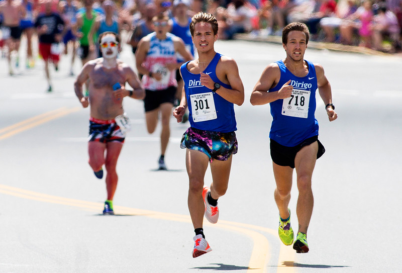 BANGOR, Maine -- 07/04/2017 - Adam Schwendt (left) and Adam Sukiennik battle for first during the 37th Annual Walter Hunt 4th of July 3K road race from Brewer to Bangor Tuesday. Schwendt and Sukiennik placed first and second respectively. Ashley L. Conti   BDN