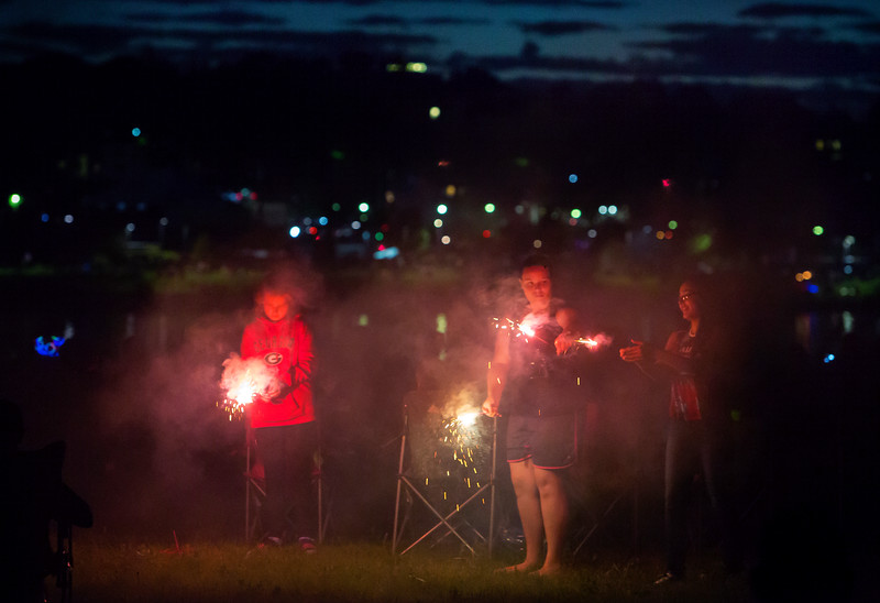 BREWER, Maine -- 07/04/2017 - Children set off sparklers near the Brewer Waterfront before the annual Kiwanis fireworks show over the Penobscot River Tuesday. Ashley L. Conti | BDN