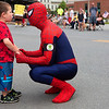 BANGOR, Maine -- 07/04/2017 - Ayden McLaughlin, 4, takes a minute to talk to Spiderman during the annual Fourth of July parade from Brewer to downtown Bangor Tuesday. Ashley L. Conti | BDN