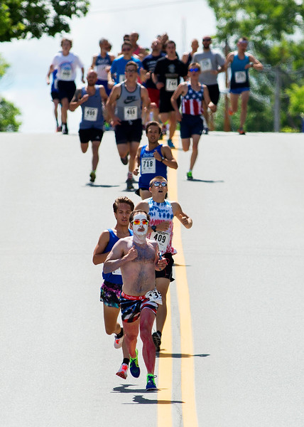 BREWER, Maine -- 07/04/2017 - Philip Lebreton (center) leads the pack during the 37th Annual Walter Hunt 4th of July 3K road race from Brewer to Bangor Tuesday. Lebreton placed seventh with Adam Schwendt taking first. Ashley L. Conti | BDN