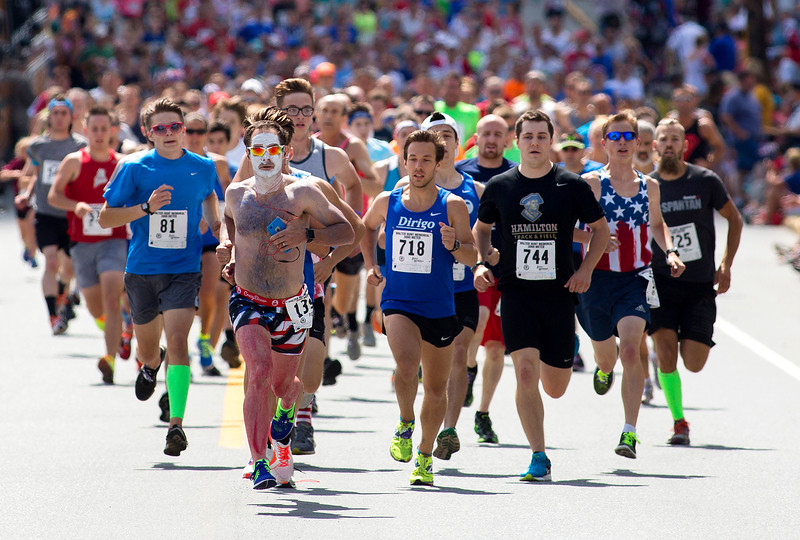 BREWER, Maine -- 07/04/2017 - Runners take off towards Bangor during the 37th Annual Walter Hunt 4th of July 3K road race from Brewer to Bangor Tuesday. Ashley L. Conti | BDN
