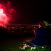 BREWER, Maine -- 07/04/2017 - A couple watches the annual Kiwanis fireworks show over the Penobscot River near the Brewer Waterfront Tuesday. Ashley L. Conti | BDN
