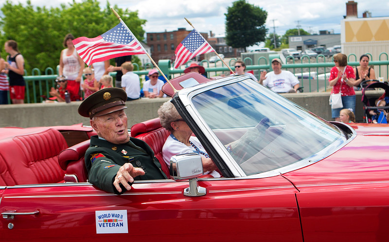 BANGOR, Maine -- 07/04/2017 - A World War II veteran rides in the annual Fourth of July parade from Brewer to downtown Bangor Tuesday. Ashley L. Conti | BDN